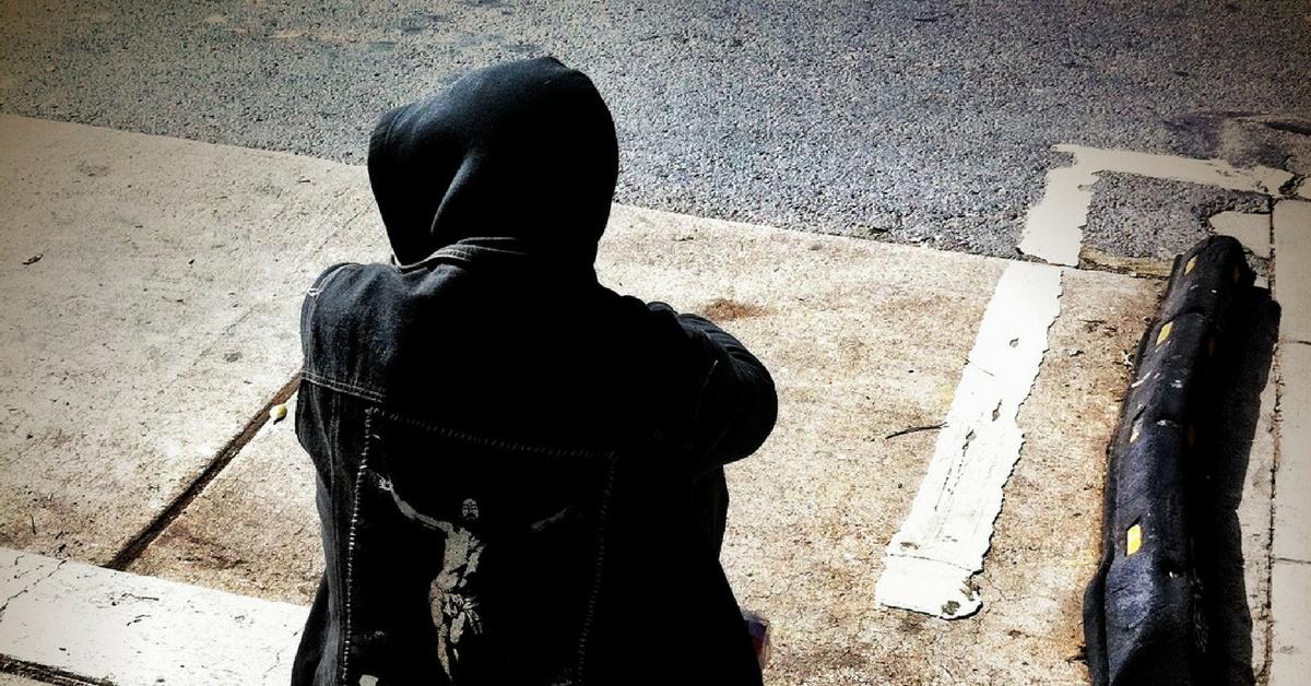 Homeless on curb.jpg